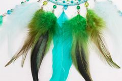 Feathers of dreamcatcher. Green feathers of dreamcatcher on white background Stock Image