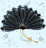 Feathers fan. On an abstract background of the carnival a big fan of black feathers, decorated with ornaments and ribbon Royalty Free Stock Image
