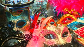 Feathers and fascination, venetian masquerade ball masks. Shop front window in Venice displaying colourful masquerade masks to entice the passerby. Stunning stock photos