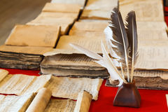 Feathers and inkpot Stock Image