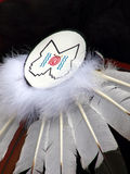 Feathers and Swirls. Native American headdress decorated with traditional symbols royalty free stock photo