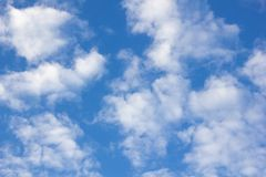 Feathery clouds in the blue sky. Feathery clouds on a blue sky lit on a summer day stock photography