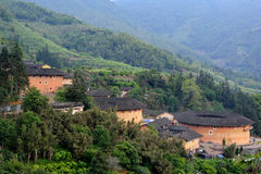 Featured Chinese residence, Earth Castle in valley. The Earth Castle of Hakka in Fujian, South of China whcih has over one thousand years history. Originally for Stock Image