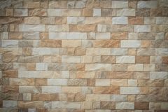 Featured stone tiles wall background texture. Clean and ordinary Royalty Free Stock Photography