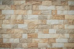 Featured stone tiles wall background texture. Clean and ordinary Stock Photos