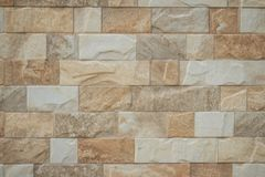 Featured stone tiles wall background texture. Clean and ordinary Stock Images