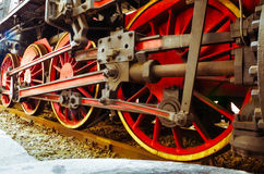 Featured wheel colored red and yellow , of an old locomotive exposed in an Italian railway station. Close up  featured wheel colored red and yellow , of an old Stock Photo