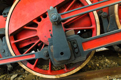 Featured wheel colored red and yellow , of an old locomotive exposed in an Italian railway station Stock Images