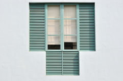 Featured window. Window in light green color with wooden grid and simple white cloth curtain Stock Photo