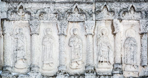 Features white stone carving at St. George`s Cathedral. Features white stone carving Georievskom Cathedral in Yuriev-Polsky winter royalty free stock photos