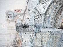 Features white stone carving at St. George`s Cathedral. Features white stone carving Georievskom Cathedral in Yuriev-Polsky winter royalty free stock photography