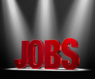 Featuring Jobs. Shiny red JOBS in the dark, gleaming under three bright spotlights Royalty Free Stock Photography