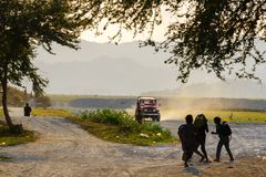 Feb 17,2018 Aeta people returning home at sunset. Capas, Philippines Stock Photography