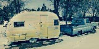 FEB 25, 2019 - COLORADO-UTAH - USA - Vintage pickup truck and yellow trailer in snow - Colorado/Utah area stock photography