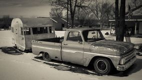 FEB 25, 2019 - COLORADO-UTAH - USA - Vintage pickup truck and yellow trailer in snow - Colorado/Utah area royalty free stock photos