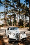 White vintage luxury classic convertible car at colonial villa royalty free stock image