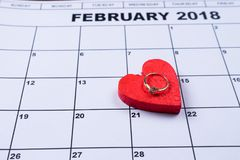 14 Feb is a decorative heart on it engagement ring with diamond. Copy paste Stock Image