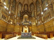 FEB 18 2014: Interior of Basilica in Benedictine Abbey of Santa Maria de Montserrat (founded in 1025) in Montserrat Royalty Free Stock Photography