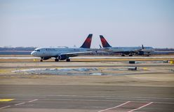 DELTA aircraft at the John F. Kennedy International Airport. It is the busiest international air passenger gateway in the U.S. FEB 14, 2019 JFK NEW YORK, USA royalty free stock photography