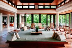 Contemporary Colonial Thai resort lobby with large daybed and Th stock image