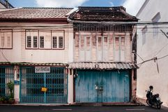 Songkhla, THAILAND - Old grunge wooden Chino-Portuguese style buildings with blue doors at Songkhla Nang Ngam street royalty free stock photos