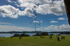 Waitangi Treaty Grounds Flag Pole. Feb 6th in New Zealand remembers waitangi day, the signing of the peace treaty between english settlers and maori tribes stock image