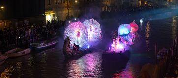 Feb 2017, Venice, Italy. Illuminated carnival floats at the opening of the carnival.. Spectators line the banks of the canaregio canal in Venice, to see the Stock Photo