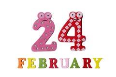 24 febbraio su fondo, sui numeri e sulle lettere bianchi Fotografia Stock