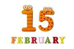 15 febbraio su fondo, sui numeri e sulle lettere bianchi Fotografia Stock