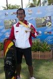 Febiandi Andri Muhamad with his medal. PUTRAJAYA, MALAYSIA - OCTOBER 9: Febiandi Andri Muhamad from Indonesia wins the bronze medal at 2011 IWWF Asian Waterski Royalty Free Stock Photo