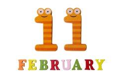 11. Februar auf weißem Hintergrund, Zahlen und Buchstaben Lizenzfreie Stockfotos