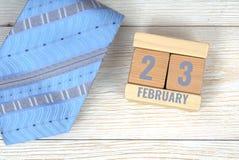 23 februari-kalenderdatum op houten blokken Royalty-vrije Stock Afbeeldingen