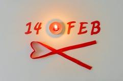 14 Februari symbol och stearinljusljus Arkivfoto