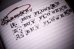 14 februari, valentindagen, köp blommar text Fotografering för Bildbyråer