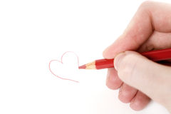 February 14th. Woman doodling with a red coloring pencil stock image