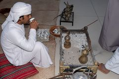 Young local Emirati man drinking tradition tea of UAE stock photo