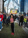 21 February 2019 - Brussels, Belgium: Young woman holding a handmade poster with slogan during a climate protest march organised. 21 February 2019 - Brussels stock images