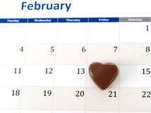 February calendar page with a heart chocolate marking valentines day Royalty Free Stock Image