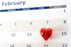 February calendar page and little red heart marking valentines day Royalty Free Stock Images