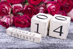 February 14 calendar and roses. Retro calendar with a festive date. Postcard to the Day of All Lovers stock photo