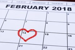 February 14, 2018 on the calendar, Valentine`s day, heart from red felt stock image