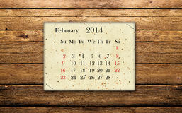 February 2014. Calendar of February 2014 on the wooden background Stock Photos