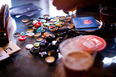 18 February 2017 - Craft beer bottle caps on a table in pub Slad in Pancevo, Serbia stock photo