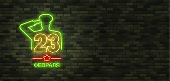 February 23. Defenders of Fatherland Day. Neon sign and green br. Ick wall. Realistic sign. National Military holiday in Russia. Template for postcard Stock Photo