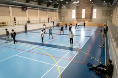 February 21, 2019. Denmark. Copenhagen. Team game with stick and ball Floorball or hockey in hall. Inside training in the gym of. The school college. Group of stock photos