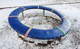 Freezing spinning wheel in the playground. February 27 2018- Freezing spinning wheel in the playground Vancouver, BC Canada Stock Photos