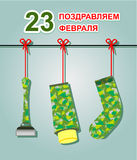 23 February. Greeting card. Defenders of the Fatherland Day. Gifts Sock on the rope, cream, razor. Text translation: Congratulations on 23 February Stock Images
