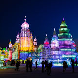 February 2013 - Harbin, China - International Ice and Snow Festival. February 2013 - Harbin, China - Tourists walking among the Ice buildings in the Stock Images