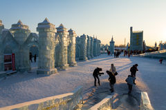 February 2013 - Harbin, China - International Ice and Snow Festival. February 2013 - Harbin, China - Tourists walking among the Ice buildings in the Stock Photo