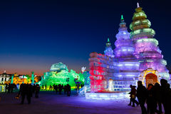 February 2013 - Harbin, China - International Ice and Snow Festival. February 2013 - Harbin, China - Tourists walking among the Ice buildings in the Royalty Free Stock Photography